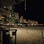 View of Waikiki at night from our table