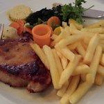 Schweizsteak (Pork Steak with French Fries and Vegetables)