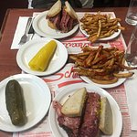 Montreal smoked meat sandwiches, fries, pickle and hot pepper