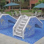 Missing mosaic tiles on slides in kiddie pool.