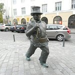 Statue of chimney sweep in front of hotel