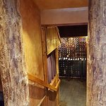 A shot of the wine cellar from the bar area. Very comfortable, rustic bar area