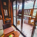 The small adjoining kitchen/tea room, with the view out onto our private balcony and spa