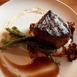 Filet, asparagus on a bread pudding (I think).