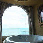 The oceanfront spa tub! Curtains can close for privacy. Super romantic.