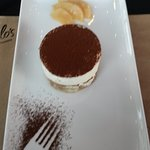 tiramisu with dusted cocoa and poached pears