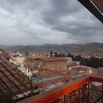 View from second floor room #304 private balcony onto Cusco and Apu