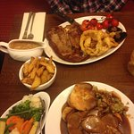 Beautiful meal! One steak and chips and a lamb roast dinner. Huge portions and great quality!