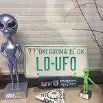 Display case of UFO paraphernalia.