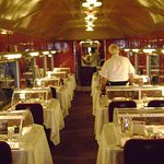 Interior of an old diner car set for dinner service.