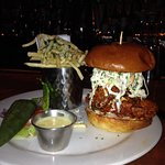 FRIED SOUTHERN FIERY CHICKEN SANDWICH AND TRUFFLE FRIES AT BAR
