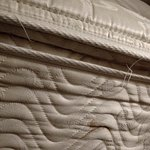 torn stitching & ugly stain on side of mattress