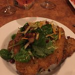 Crisp pork chops, thinly sliced, with greens, bacon, mashed sweet potatoes.