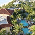 The beach, a bedroom, pool area & lobby at La Playa