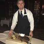 Our wonderful waiter, Drew, with the Tomahawk.