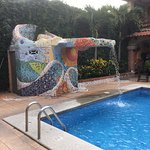 Tiled fountain into pool.
