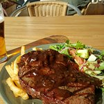 A tender piece of steak with red wine sauce, and garden salad. Yummy..