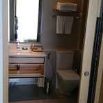 Bathroom with standing shower by the right side