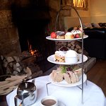 Afternoon tea by the log fire