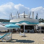 Barco Beach restaurant seashore view showing bar on the prow upstairs, beach level dining & loun
