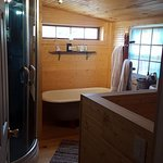 Bathroom with steam shower and claw tub
