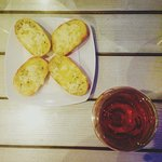Garlic bread and rose wine
