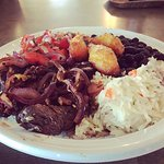 Grilled marinated steak with rice, beans, pico de gallo and sweet plantains **special**