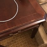worn, scratched, shabby old end table.
