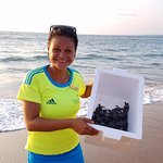 Activity director Lorena, releasing baby turtles in to the sea.