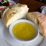 The bread and dipping oil comes before your entree. Be careful. It's good, but it's filling!