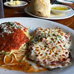 The Eggplant Parmesan comes with a side of Spaghetti.