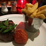 Well cooked soft, juicy fillet steak with hand-cut chips