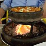 Chicken stew traditional turkish coal under claypots.