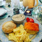 An extra-large southern-style biscuit, savory sausage gravy, Glenwood grits, & soft-scrambled eg