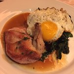 Pheasant under fried egg and kale