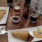 European craft beer and pastor meat cones