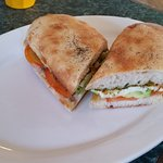 Pesto, tomato, avocado & halloumi toasty on Turkish bread.
