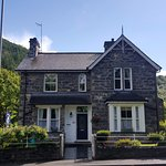 Bod Gwynedd B and B. Surrounded by trees, opposite a river and a short walk into the village