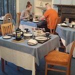 Uncleared tables surround lone guests in Crown Guest House 20161015_084852