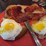 Breakfast - 2 eggs sunny side up, toast & bacon and my plate 2 blueberry pancakes & bacon. Delic