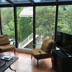 Sunroom attached to room with exterior balcony.