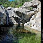 waterfall and swiming pool in the granite boulders