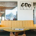 sit & sip coffee in our cozy mid century inspired lobby