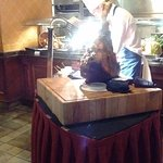A chef carving up the joint of beef