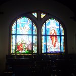 Inside the church. Stained glass windows. See Jesus Rising!