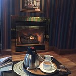 Coffee in Front of Fireplace in Captains Den
