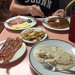 Pumpkin pancakes with ham and scrambled eggs, bacon, home fries and 1/2 order of biscuits and gr