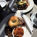 Poached eggs on sourdough with mushrooms, bacon, avocado, goats cheese and a breakfast bagel. An