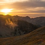 a lovely sunset over the parang mountains romania