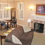 Large living room with working gas fireplace, dining area, kitchen and half-bath on first floor.